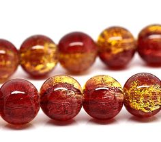 Take a peek at these truly lovely beads... two toned crackle glass with tones of a red and a sophisticated gold... Perfect for all sorts of