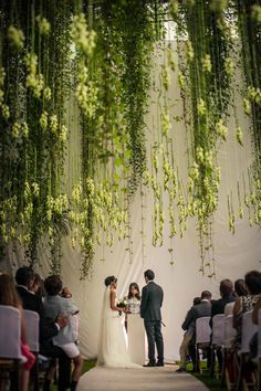 Modern Appeal: Talk about getting married under a canopy of flowers! This Portugal wedding stuns with a two-tone color scheme, high ceilings, and a mass of cascading vines.