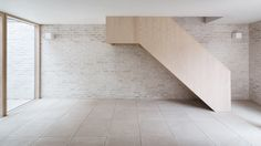Mews House is a minimal home located in London, England, designed by Russell Jones.