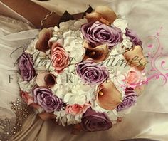 White hydrangea, mini calla lilies, peach and lavender roses. Very antique looking!