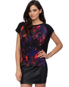 d4bceb2aed Botanical Print Spliced Blouse is perfect for night-time festivities with a  striking