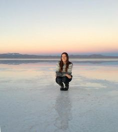 Sunset over the water at the Uyuni Salt Flats, Bolivia - The Borderless Project l @tbproject
