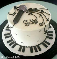 Black and white piano music cake