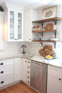 Vintage kitchen remodel. White shaker cabinets, marble countertops, white subway tile, and open shelving. by batjas88 #kitchenremodeling