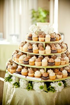 This cupcake display is a great alternative to having a traditional wedding cake. YUM! {SB Childs Photography}