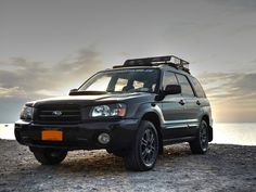 2004 Java Black Pearl Subaru Forester XT on the beach at sunset!  www.turboforester.org SG FXT with Curt roof basket and painted grill.  Member of the Snail Mafia!  www.snailmafia.com FTW