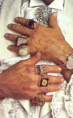 Liberace and his fabulous jewels. Remember seeing up close (first row of a spectacular show) his grand piano watch (left hand) and his candelabra ring on his index finger (right hand). Superb custom-made jewelry and expensive.