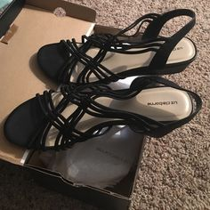 Liz Claiborne Black Strappy Sandals Beautiful summer sandals in size 9.5 medium. I usually wear wide but these fit perfectly! Worn 2 or 3 times and in like new condition. I wore them to my office and got lots of compliments! Liz Claiborne Shoes Sandals