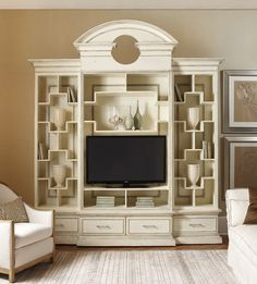 We've added a new twist to one of our most popular designs! Our American Treasures® Nassau Home Theatre is now available with an antique mirror back. Contact us today to learn more.