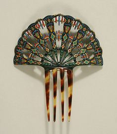 Egyptian Revival Hair Comb whose design mimics the peacock's tail