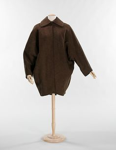 """1952, America - Wool coat """"Cocoon"""" by Charles James I had a grey wool """"cocoon"""" dress with a large white collar in 1956 - the collar had a grey sheer silk organza bow in the middle. Stunning, with little black patent """"French"""" heels."""