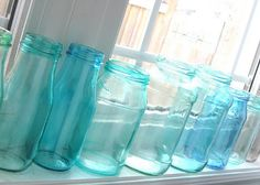 "Turn clear glass jars into ""vintage"" blue jars with glue and food coloring -- this pin has the correct link!"