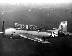 A Grumman TBM-3 Avenger torpedo bomber in flight over Okinawa, 1945.