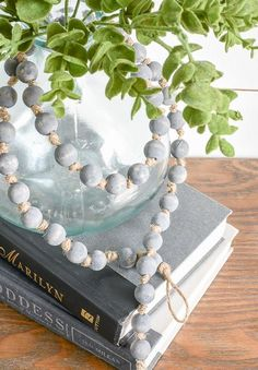to Make an Inexpensive Knotted Wood Bead Garland Add contrast and texture to your farmhouse decor with this simple knotted wood bead garland.Add contrast and texture to your farmhouse decor with this simple knotted wood bead garland. Wood Bead Garland, Beaded Garland, Rag Garland, Bead Crafts, Diy And Crafts, Fall Crafts, Ornament Crafts, Ornaments, Deco Zen