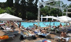Public Pool in Rome : All'Ombra del Colosseo. It opens every summer on top of the Celio Hill with amazing views of the Colosseum, Constantine Arch, and the Palatino Hills