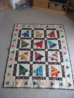 This is a group quilt made row by row. I did the top row and my three friends did a row each. Pattern is called Tipsy Trees.