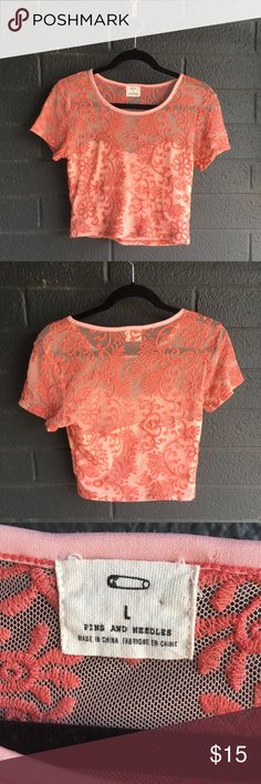 Urban Outfitters Embroidered Crop Top Lovely coral colored embroidered crop top by Pins & Needles for Urban Outfitters. Mesh upper with sweetheart neckline for a flirty touch. The embroidery is in great condition, with a few areas that appear a little looser-- but nothing outstanding! Great top in great condition. Urban Outfitters Tops Crop Tops