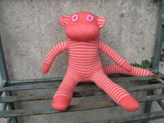 Coral and Cream Stripy Baby Sock Monkey by TheVioletPincushion