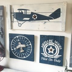 This is a SET OF THREE vintage airplane art pieces - a plane, a compass, and a pilot on duty sign, each with a three dimensional rustic touch (a jute outlined plane on the compass, rusty barn stars on the plane and sign, and decorative cut metal nail heads). Each piece is painted on a rustic wood slat canvas and then distressed using our custom techniques. Rustic/vintage airplane art is perfect for a nursery, bedroom, game room, man cave or anywhere a little fun is needed! And, you can c...
