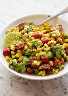 A simple, super tasty Corn Salad made with fresh or canned corn, avocado and juicy tomatoes, finished with a fresh lime dressing. I love the combination of flavours in this salad combined with the creamy avocado! Corn Salad Recipes, Corn Salads, Avocado Recipes, Healthy Recipes, Vegetable Salads, Salad Dishes, Food Salad, Fresh Corn Salad, Corn Avocado Salad