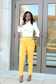 Yellow straight leg trousers. Outfit would work well with any coloured trousers