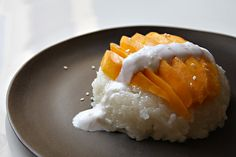 Thai coconut sticky rice with mango....one of my family's favorite desserts!  We especially love it when the champagne mangos are in season.