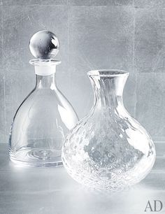 From left: Glass Rye decanter ($175) and Royalton carafe ($155) by Simon Pearce