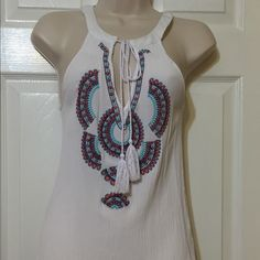 LA Hearts V-Neck Tank Top The top is 100 percent rayon.  Has turquoise and rose colored embroidery in front.  Has ties at neckline with tassels at the bottom of the ties. Excellent condition.  Only worn a few times. LA Hearts Tops Tank Tops