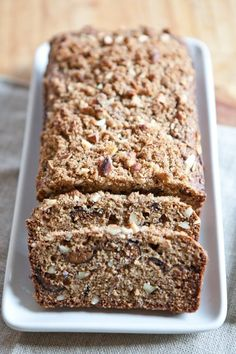 Almond-Fig Breakfast Quick Bread —  dried figs 3/4 cup all-purpose flour 3/4 cup whole-wheat flour 1/2 cup almond meal 2 teaspoons baking powder 1/2 teaspoons ground cinnamon 1/2 teaspoon ground allspice 2 large eggs 1/3 cup plain yogurt 1/2 teaspoon almond extract 3/4 cup chopped whole almonds