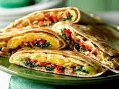Breakfast burritos  Ingredients 6 eggs, lightly beaten ¹ ⁄³ cup reduced-fat milk ½ cup grated KRAFT Light Natural Cheese Olive oil cooking spray 1 garlic clove, crushed 2 bacon rashers 1 small red capsicum, thinly sliced 150g baby spinach leaves 2 tsp seeded mustard 4 flour tortillas Extra ²⁄³ cup grated KRAFT Light Natural Cheese Method  1 Whisk eggs, milk and cheese until combined. Spray a small non-stick frying pan with oil and heat on medium. Pour in a quarter of the egg mixture and cook until eggs are almost set. Turn and cook for 10 seconds or until eggs are set. Remove from heat and keep warm. Repeat to make 3 more omelettes. 2 Spray pan with oil, add garlic, bacon and capsicum and sauté until vegetables are softened. Add spinach and mustard and cook until spinach is wilted. 3 Top each tortilla with an omelette and bacon mixture. Add extra cheese, then fold to enclose filling. Spray pan with oil, heat on medium and cook burritos for 1-2 minutes on each side until crisp and golden. Serve.