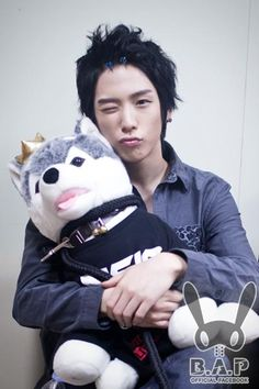 Brownie receives a back hug from B.A.P.'s Himchan
