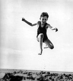 Playing on the beach. Jumping for joy! 1938 Jacques-Henri Lartigue