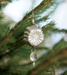 tart tin christmas tree   ... ornament fashioned from an antique tart tin adorns the christmas tree