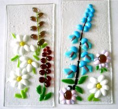 Posting some older work - pebbles cut in half and 4ths and used for petals in these pieces. Works very well. Tack fused.