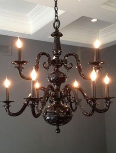 Get a cheap brass chandelier from a thrift store or craigslist and spray paint it to create a black chandelier.  Add acrylic crystals.  Going to make my own and hang it over the dance floor.