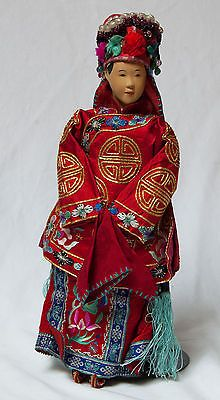 "A stunning early ""Traditional Bride"".  Yet young women, as brides, were often sent away from their family to that of her new husband, alone, to begin her new life. Chinese children of this and earlier eras did not play with dolls per se, and these are thought to be very real representatives of their counterparts in the human world."