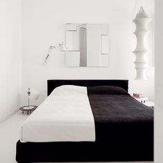 black & white bed...This is a great photo.  It truly, makes one think about how well the two colors compliment one another.