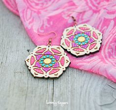 Hey, I found this really awesome Etsy listing at http://www.etsy.com/listing/120550876/wood-earrings-with-pink-and-purple