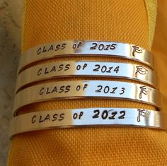 Class of 2013, 2014, 2015, 2016 - Custom Hand-Stamped Metal Bracelet (hcl2.25). $11.95, via Etsy.
