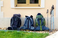 Backpacks lined up at a cafe on the Camino trail Great information about the camino