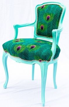 Peacock printed fabric on a diningroom chair. Love the painted turquoise arms and legs..love painted wood/furniture