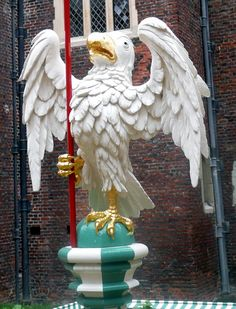 Silver Falcon of the Plantagenets on top of a decorated bollard at the Hampton Court Palace in London, England;  photo by Patrick Baty, a Historical Paint Consultant working at Hampton Court Palace to keep the colors of many places/ palaces/ objects historically correct