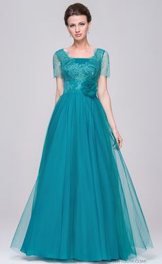 Elegant with flowing detail, you'll adore this floor length tulle gown. #jjshouse #motherdress