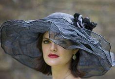 <3  Multi-layered black hat.  So feminine. sinamay