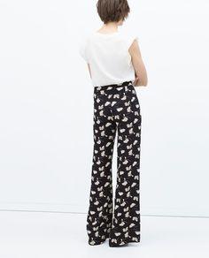 Zara bell bottom trousers in print.