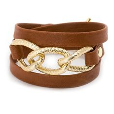 Parker Wrap Bracelet in Brown - this wrap bracelet features a chunky, textured chain centered on a leather strand and winds around the wrist three times. The combination of the leather and chain detail creates for a design that is ultra stylish and good for any look.