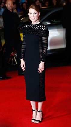 Julianne Moore wears Balenciaga to the World Premiere of 'The Hunger Games: Mockingjay Part 1' in London, England. via @stylelist