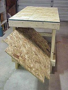 Installing shelf plywood by tilting on an angle to fit between legs of workbench.