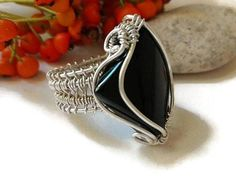 Sterling silver wire wrapped ring, Black agate cabochon ring, Sterling silver ring, Gemstone ring, Statement ring, Wire wrapped jewelry This ring is handmade with black agate cabochon and sterling silver wire, fits in a 7 finger, US size I hand make each piece with love. A little bit of #silverwirerings