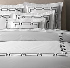 RH's Italian Metropolitan Stitch Duvet Cover:FREE SHIPPINGA classic geometric pattern provided the inspiration for our collection. Woven and tailored in Italy, the bedding's embroidered interlocking motif traces a bold border on ultra-smooth cotton percale.